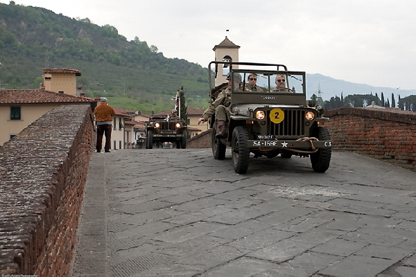 The picture shows the freshly restored Willys of 169th Engineer Combat Battalion crossing the Medici's Bridge in Pontassieve near Florence in 2009.