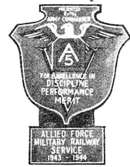 """Photo Caption: 5th Army Plaque and Clasp presented to MRS by Lt. Gen. Mark W. Clark [Inscription reads:""""Presented by the Army Commander / For Excellence in Discipline Performance Merit / Allied Force MilitaryRailway Service 1943 - 1944""""]"""