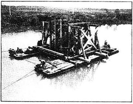 A temporary pier was then floated out to carry the load.