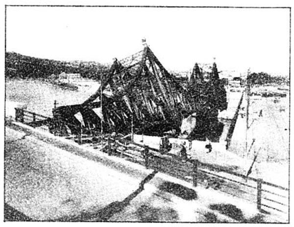Photo Caption: Wrecked railroad bridge across Soane river at Lyon, France.