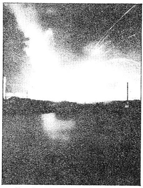 Photo Caption: Phosphorus bombs explode on burning ammo train.