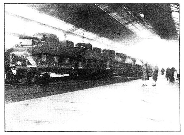 Photo Caption: Tanks move from ports to battle lines in USA car flats.