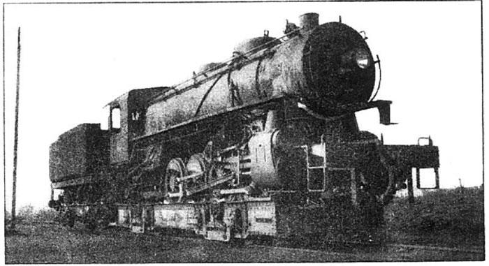Photo Caption: Meter-gauge locomotive travels on well car