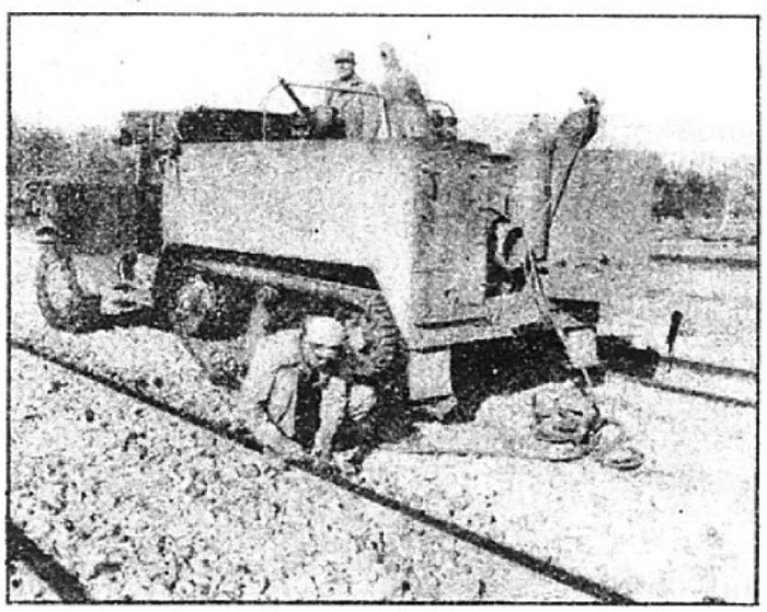 Photo Caption: Rail welders, with eye peeled for enemy aircraft.